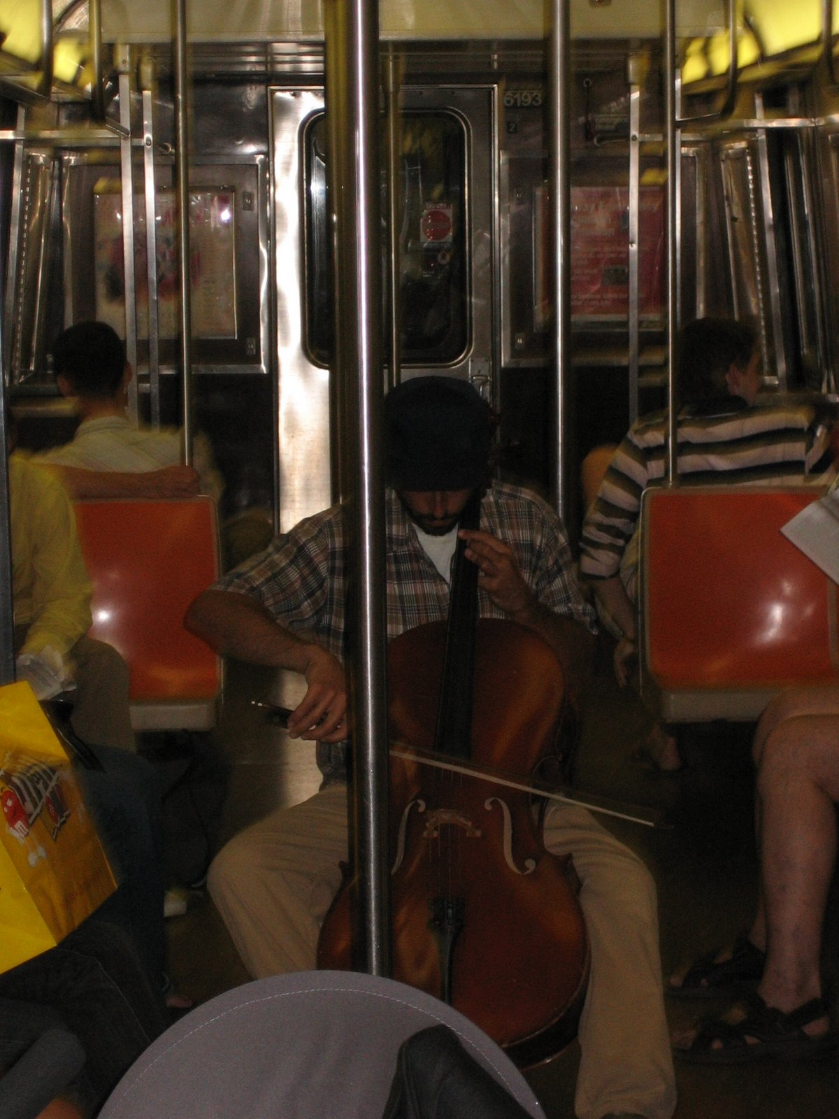 A cellist playing on a moving